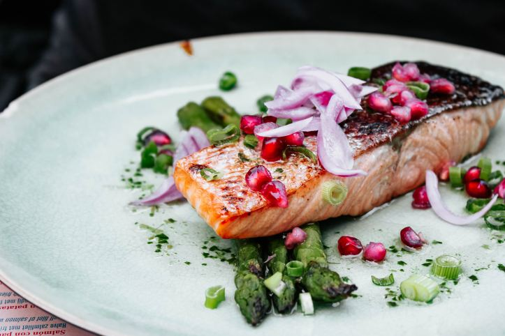 photo of cooked salmon with onions and asparagus