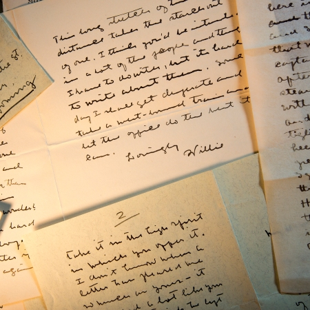 image of hand-written letters on yellowed paper