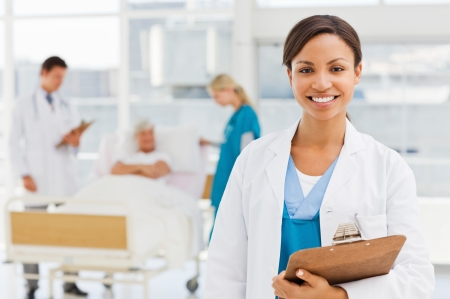 image of smiling gynecology doctor holding clipboard