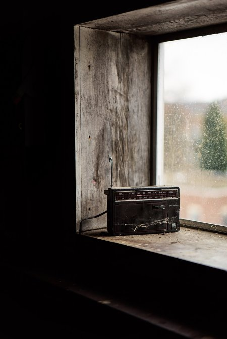 image of old-fashioned radio on a wood window sill