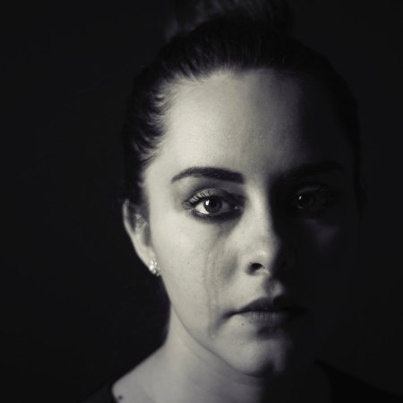 black & white image of woman crying