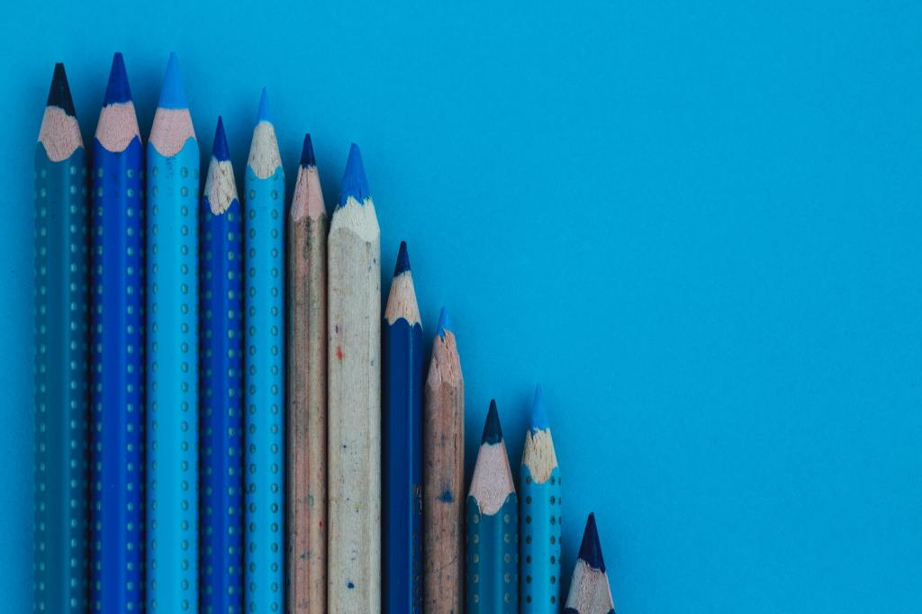 Image of 12 colored pencils in various shades of blue.